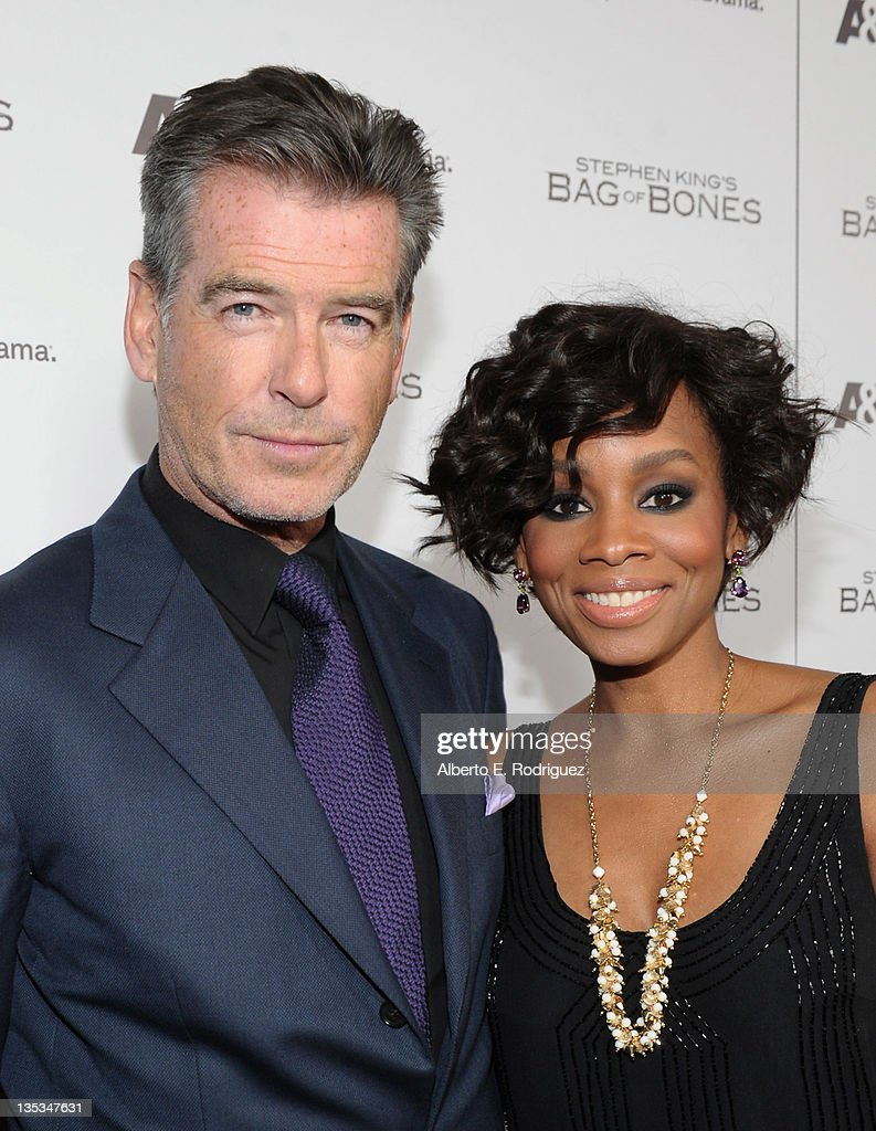 Actor Pierce Brosnan and actress Anika Noni Rose attend A&E's premiere party event for Stephen King's 'Bag of Bones' at Fig & Olive Melrose Place on December 8, 2011 in West Hollywood, California.