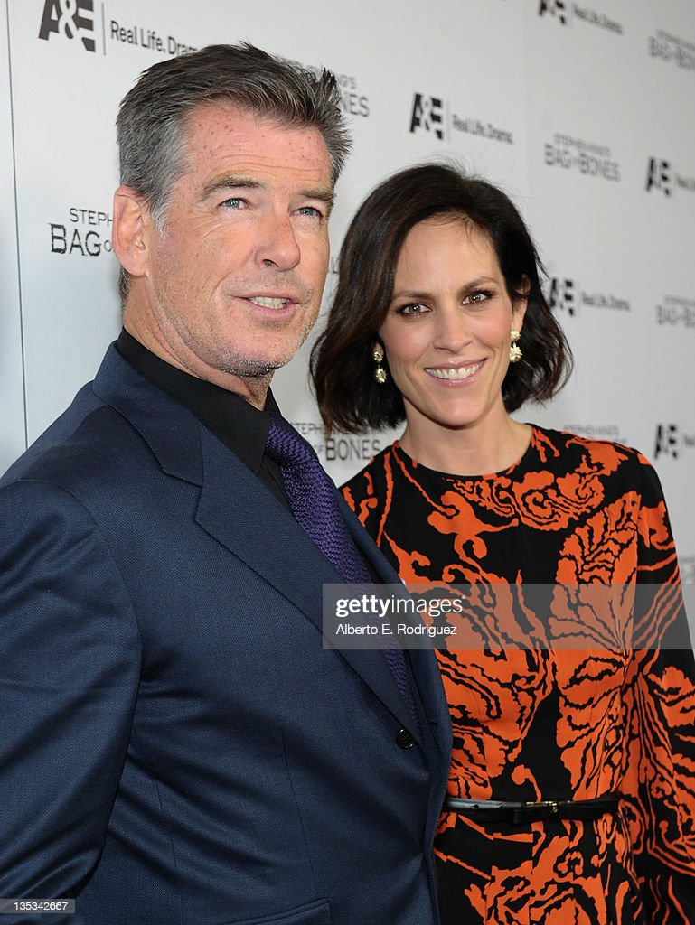 Actor Pierce Brosnan and actress Annabeth Gish attend A&E's premiere party event for Stephen King's 'Bag of Bones' at Fig & Olive Melrose Place on December 8, 2011 in West Hollywood, California.