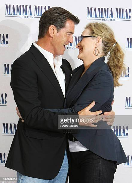 Actor Pierce Brosnan and actress Meryl Streep attend the photocall for Mamma Mia The Movie at the Adlon Hotel on July 3 2008 in Berlin Germany