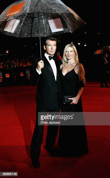 Actor Pierce Brosnan and daughter Charlotte arrives at The Orange British Academy Film Awards at the Odeon Leicester Square on February 19 2006 in...