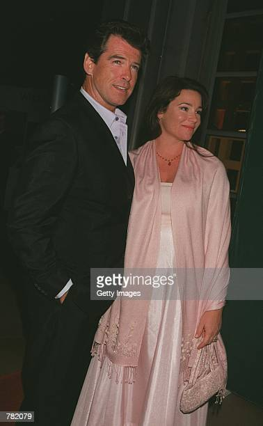 Actor Pierce Brosnan and his fiancee journalist Keely Shaye Smith pose at the premiere of Why Are We Here the Public Awareness Campaign produced by...
