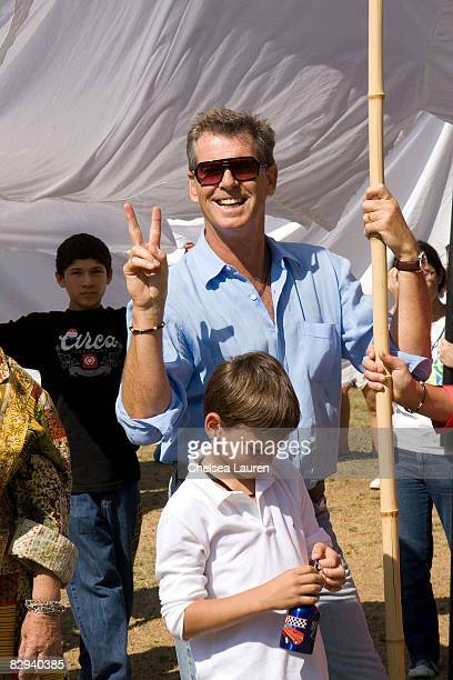 Actor Pierce Brosnan and his son Paris attend Roots Shoots Day of Peace at Griffith Park on September 21 2008 in Los Angeles California