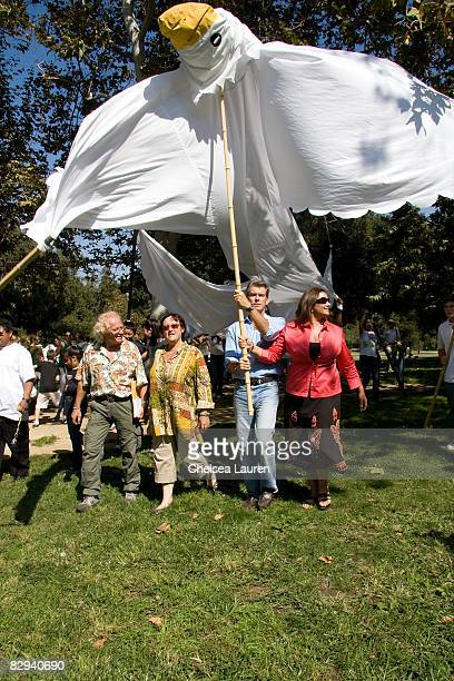 Actor Pierce Brosnan and his wife Keeley Shaye Smith attend Roots Shoots Day of Peace at Griffith Park on September 21 2008 in Los Angeles California