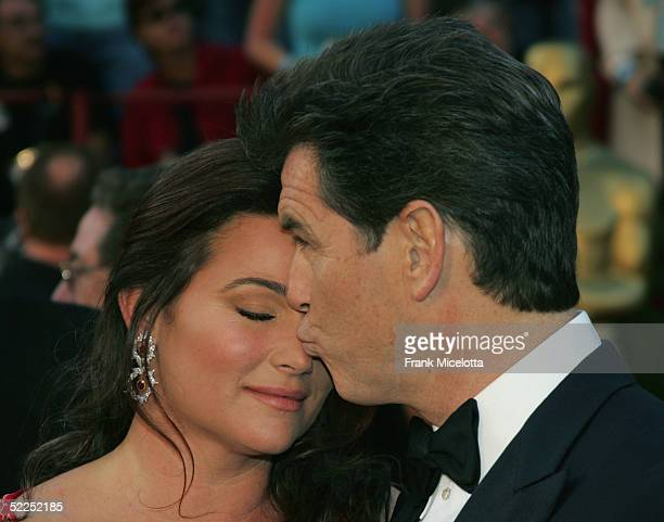 Actor Pierce Brosnan and his wife Keely Shaye Smith arrive at the 77th Annual Academy Awards at the Kodak Theater on February 27 2005 in Hollywood...