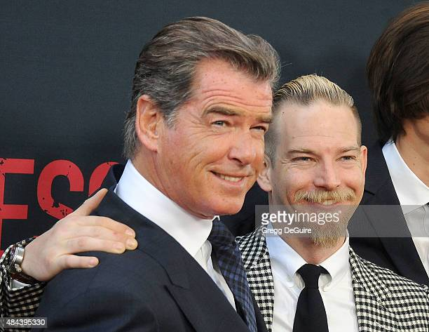 Actor Pierce Brosnan and son Sean Brosnan arrive at the premiere of The Weinstein Company's No Escape at Regal Cinemas LA Live on August 17 2015 in...