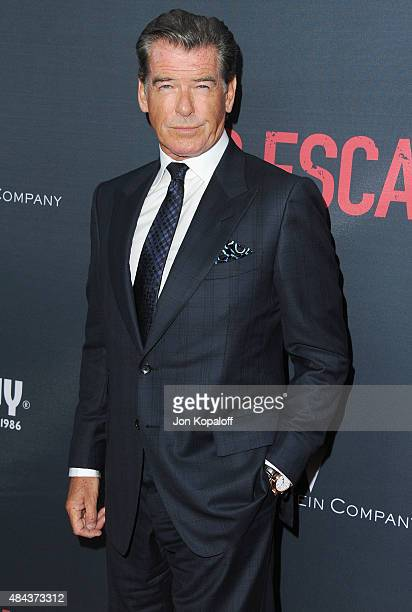 Actor Pierce Brosnan arrives at the Los Angeles Premiere 'No Escape' at Regal Cinemas LA Live on August 17 2015 in Los Angeles California