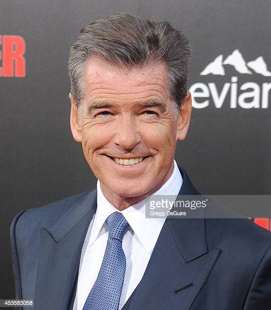 Actor Pierce Brosnan arrives at the Los Angeles premiere of 'The November Man' at TCL Chinese Theatre on August 13 2014 in Hollywood California