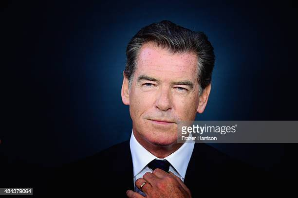 Actor Pierce Brosnan arrives at The Premiere Of The Weinstein Company's No Escape at Regal Cinemas LA Live on August 17 2015 in Los Angeles California