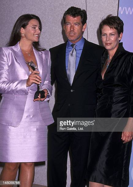 Actor Pierce Brosnan girlfriend Keely Shaye Smith and actress Jamie Lee Curtis attend the 25th Annual Women in Film Crystal Awards on June 8 2001 at...