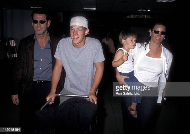 Actor Pierce Brosnan girlfriend Keely Shaye Smith son Sean Brosnan and Dylan Brosnan on July 29 1999 at the Los Angeles International Airport in Los...