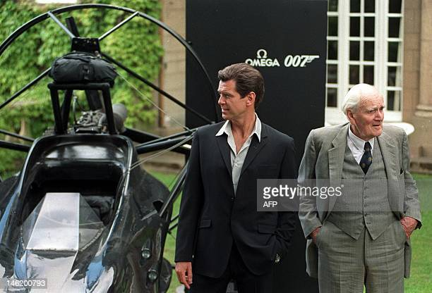 Actor Pierce Brosnan poses for a photograph with Desmond Llewelyn better known as the James Bond character 'Q' 05 June at Pinewood studios to promote...