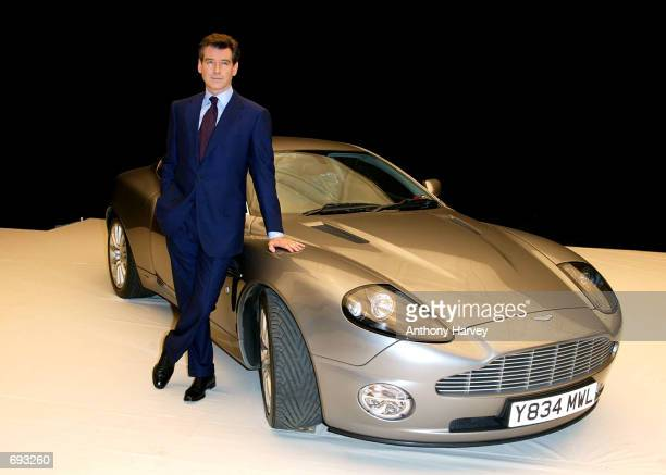 Actor Pierce Brosnan poses for photographers January 11 2002 during the press launch of the new James Bond movie with the working name 'Bond 20' at...