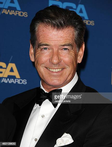 Actor Pierce Brosnan poses in the press room at the 67th annual Directors Guild of America Awards at the Hyatt Regency Century Plaza on February 7...