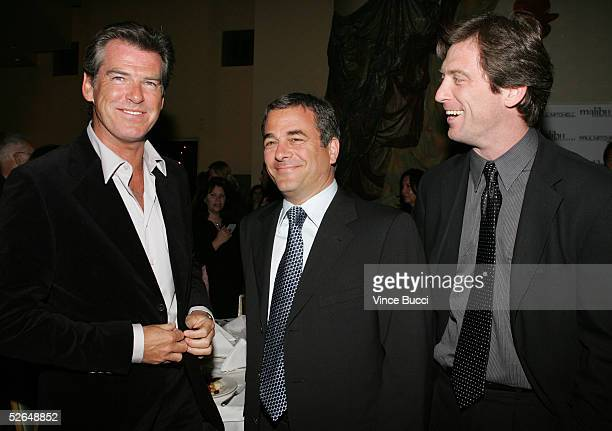 Actor Pierce Brosnan poses with CAA's Rick Kurtzman and Mike Nilon at the 6th Annual Malibu Film Festival Awards Night at Granita on April 18, 2005...