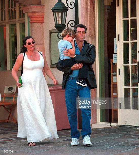 Actor Pierce Brosnan takes an afternoon stroll with his son Dylan Thomas and his pregnant fiancee journalist Keely Shaye Smith after having lunch...