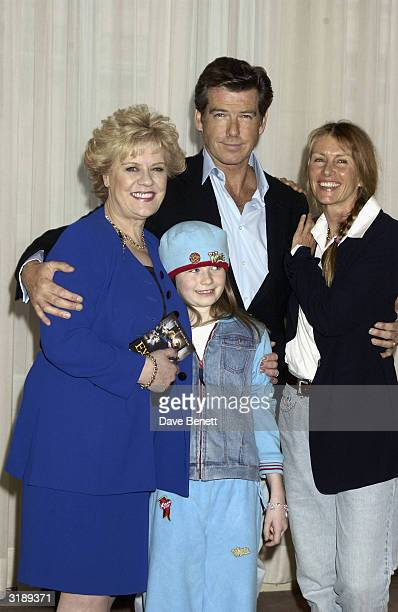 Actor Pierce Brosnan with authoress Evelyn Doyle actress Sophie Vavasseur and producer Beau St Clair attend a photocall for the motion picture...