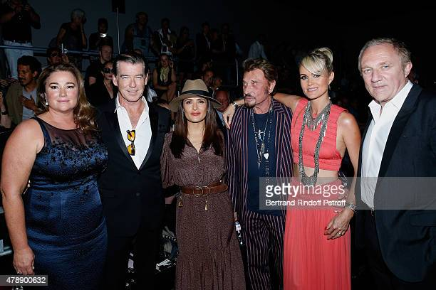 Actor Pierce Brosnan with his wife Journalist Keely Shaye Smith Actress Salma Hayek Singer Johnny Hallyday with his wife Laeticia and FrancoisHenri...