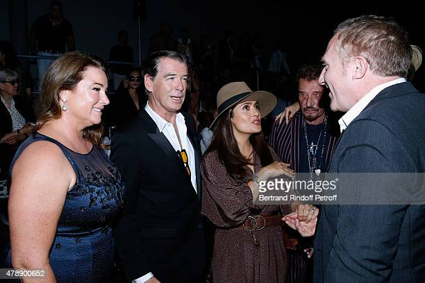 Actor Pierce Brosnan with his wife Journalist Keely Shaye Smith Actress Salma Hayek Singer Johnny Hallyday and FrancoisHenri Pinault attend the Saint...