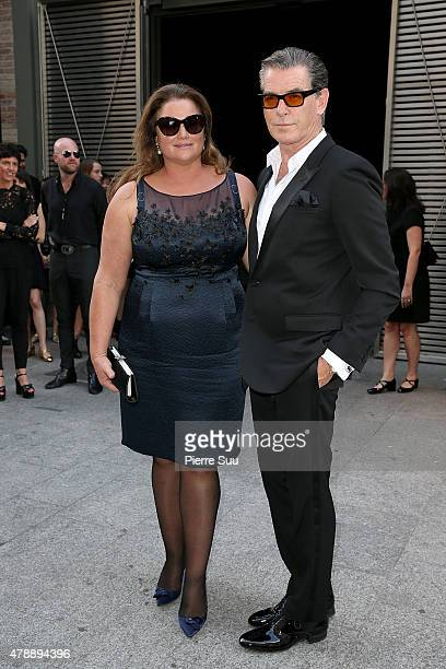 Actor Pierce Brosnan with his wife Journalist Keely Shaye Smith attend the Saint Laurent Menswear Spring/Summer 2016 show as part of Paris Fashion...
