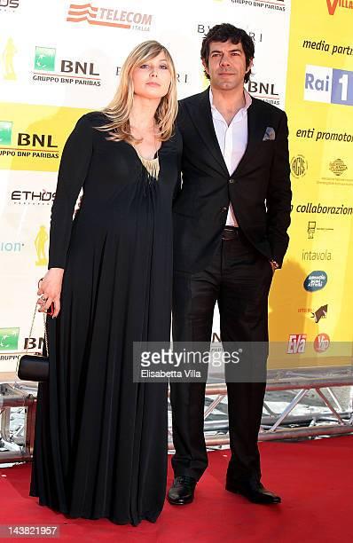 Actor Pierfrancesco Favino and Anna Ferzetti arrive at the 'Premi David di Donatello' awards ceremony at the Auditorium Della Conciliazione on May 4...