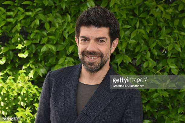 Actor Pierfrancesco Favino attends a photocall for 'Moglie E Marito' on April 11 2017 in Milan Italy
