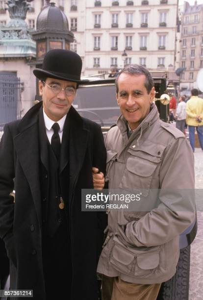 Actor Pierre Arditi left with film director Edouard Molinaro on the set of French Tv movie 'Les Grandes Familles' on September 21 1988 in Paris France