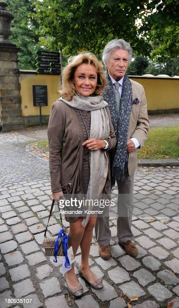 Actor Pierre Brice arrives with his wife Hella Krekel prior to a press conference with the Dalai Lama on September 18 2013 in Hanover Germany Today...