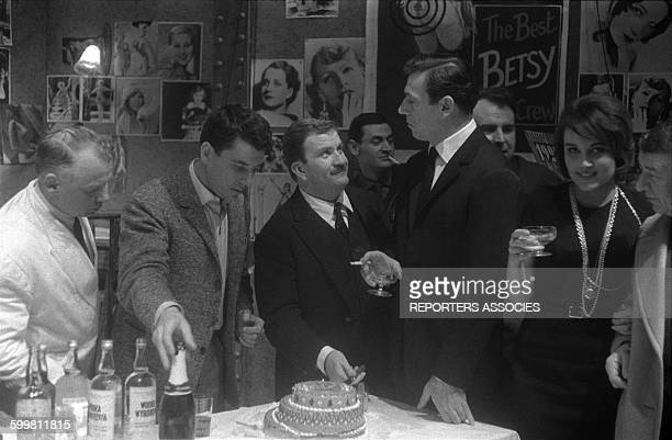 Actor Pierre Mondy's birthday at the Théâtre de la Renaissance with actors Philippe Nicaud Yves Montand and Pascale Roberts in Paris France in...