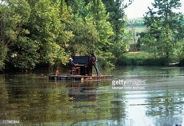 Actor playing piano on river raft in a scene from the film 'The Color Purple' 1985