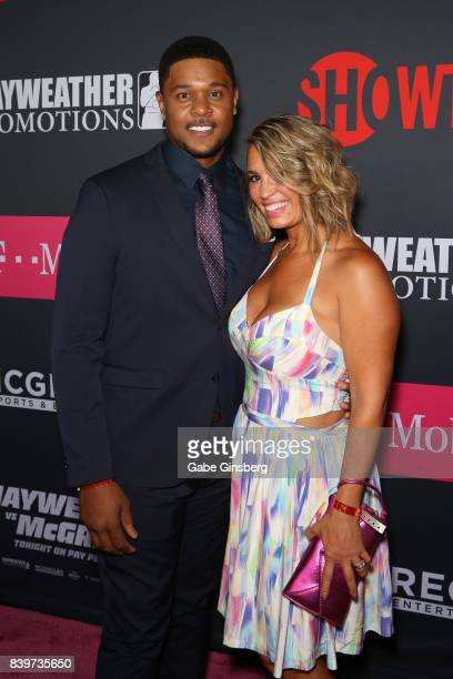 Actor Pooch Hall and his wife Linda Baptista Hall arrive on TMobile's magenta carpet duirng the Showtime WME IME and Mayweather Promotions VIP...