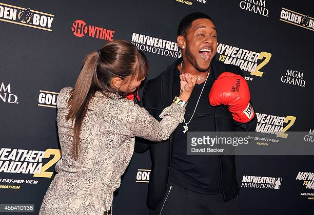 Actor Pooch Hall and his wife Linda Hall goof around on the red carpet as they arrive at Showtime's VIP prefight party for 'Mayhem Mayweather vs...