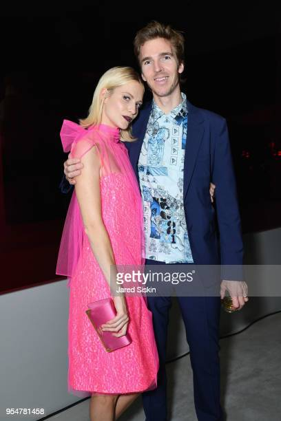 Actor Poppy Delevingne and James Cook attends the Prada Resort 2019 fashion show on May 4 2018 in New York City