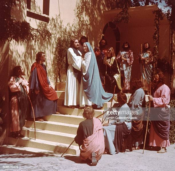 A actor portraying Jesus Christ addresses a crowd of men and women also actors in a scene depicting events of Jesus' farewell at Bethany as part of...