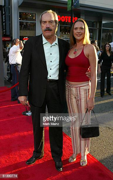Actor Powers Boothe and daughter Parisse Boothe arrives at the film premiere of Ladder 49 at El Capitan Theatre on September 20 2004 in Hollywood...
