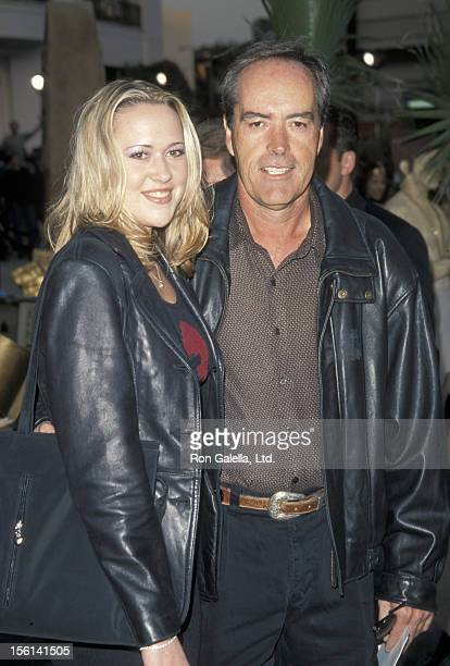 Actor Powers Boothe and guest attend the premiere of 'The Mummy' on May 4 1999 at the Cineplex Odeon Cinema in Century City California