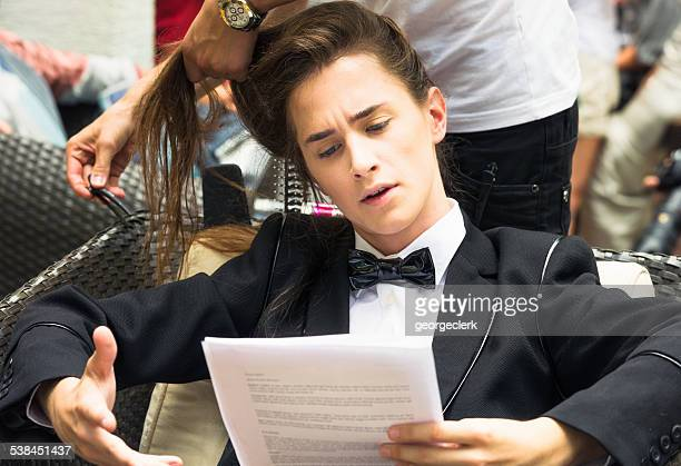 actor practising script backstage - actor stockfoto's en -beelden