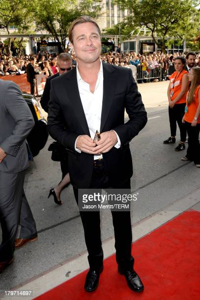 Actor/ producer Brad Pitt arrives at the 12 Years A Slave Premiere during the 2013 Toronto International Film Festival at Princess of Wales Theatre...