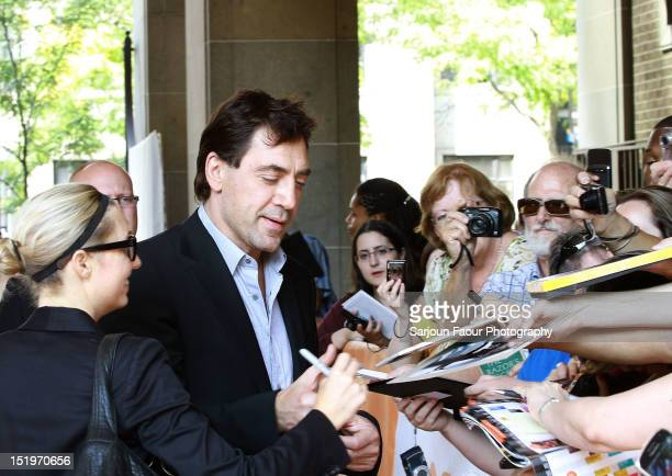 Actor/ Producer Javier Bardem signs autographs for fans at the Sons Of The Clouds The Last Colony premiere during the 2012 Toronto International Film...