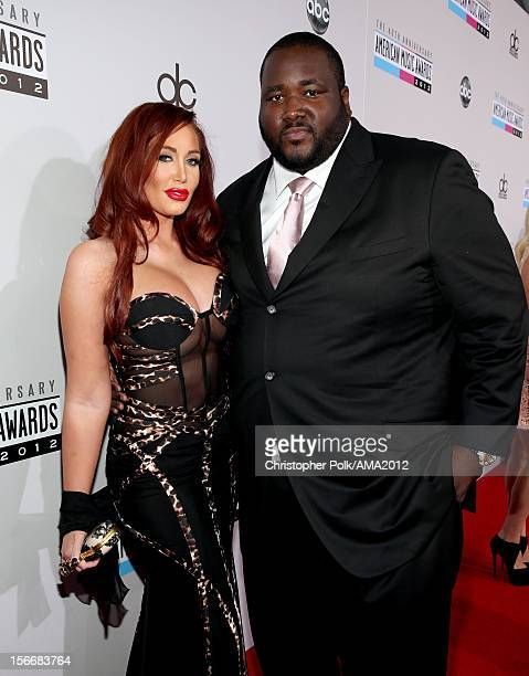 Actor Quinton Aaron and model Jenna Bentley attend the 40th American Music Awards held at Nokia Theatre LA Live on November 18 2012 in Los Angeles...