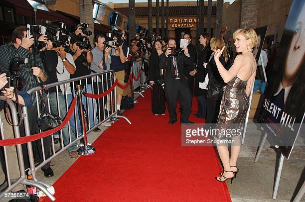 Actor Radha Mitchell poses for photographers at the premiere of TriStar Pictures' Silent Hill at the Egyptian Theatre on April 20 2006 in Hollywood...
