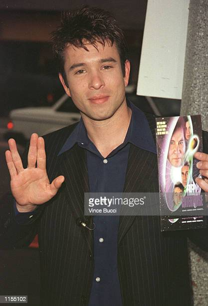 """Actor Rafer Weigel gives the Star Trek """"live long and prosper"""" sign as he arrives with his ticket to the premiere of his new film """"Free Enterprise""""..."""