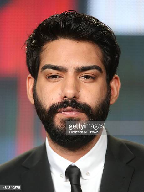 Actor Rahul Kohli listens onstage to a question from the media audience during the 'iZombie' panel as part of The CW 2015 Winter Television Critics...