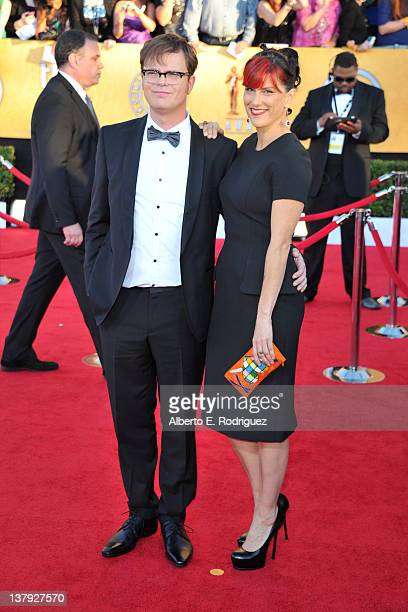 Actor Rainn Wilson and Holiday Reinhorn arrive at the 18th Annual Screen Actors Guild Awards at The Shrine Auditorium on January 29 2012 in Los...