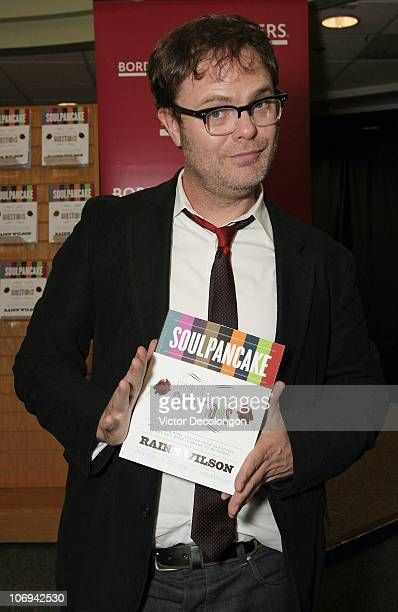 Actor Rainn Wilson poses for a photo holding his book 'SoulPancake' after a book signing on November 17 2010 in Los Angeles California