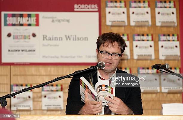 Actor Rainn Wilson prepares to read an excerpt from his book to the audience during a book signing for his book 'SoulPancake' on November 17 2010 in...