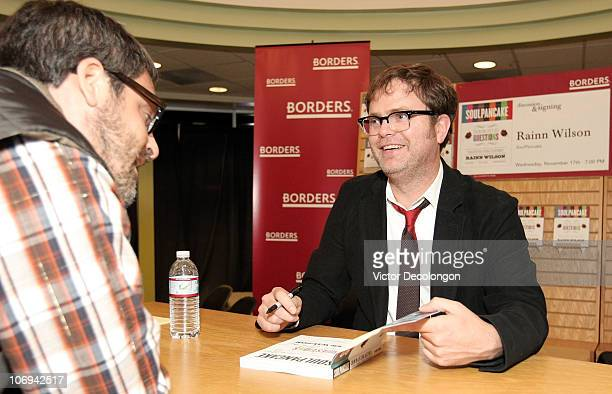 Actor Rainn Wilson signs a book for a fan during a book signing for his book 'SoulPancake' on November 17 2010 in Los Angeles California