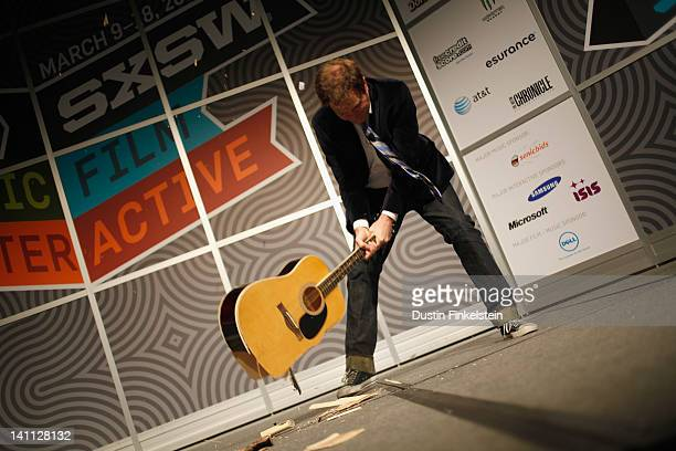 Actor Rainn Wilson smashes a guitar onstage at The View from Inside Rainn Wilson's Brainstem during the 2012 SXSW Music Film Interactive Festival at...