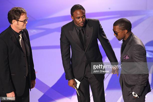 Actor Rainn Wilson TV Personality Wayne Brady and Rapper Kanye West during the 59th Annual Primetime Emmy Awards at the Shrine Auditorium on...
