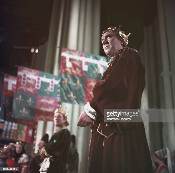 Actor Ralph Richardson in costume as the Duke of Buckingham with actor John Gielgud in the background as George Duke of Clarence in a scene from the...