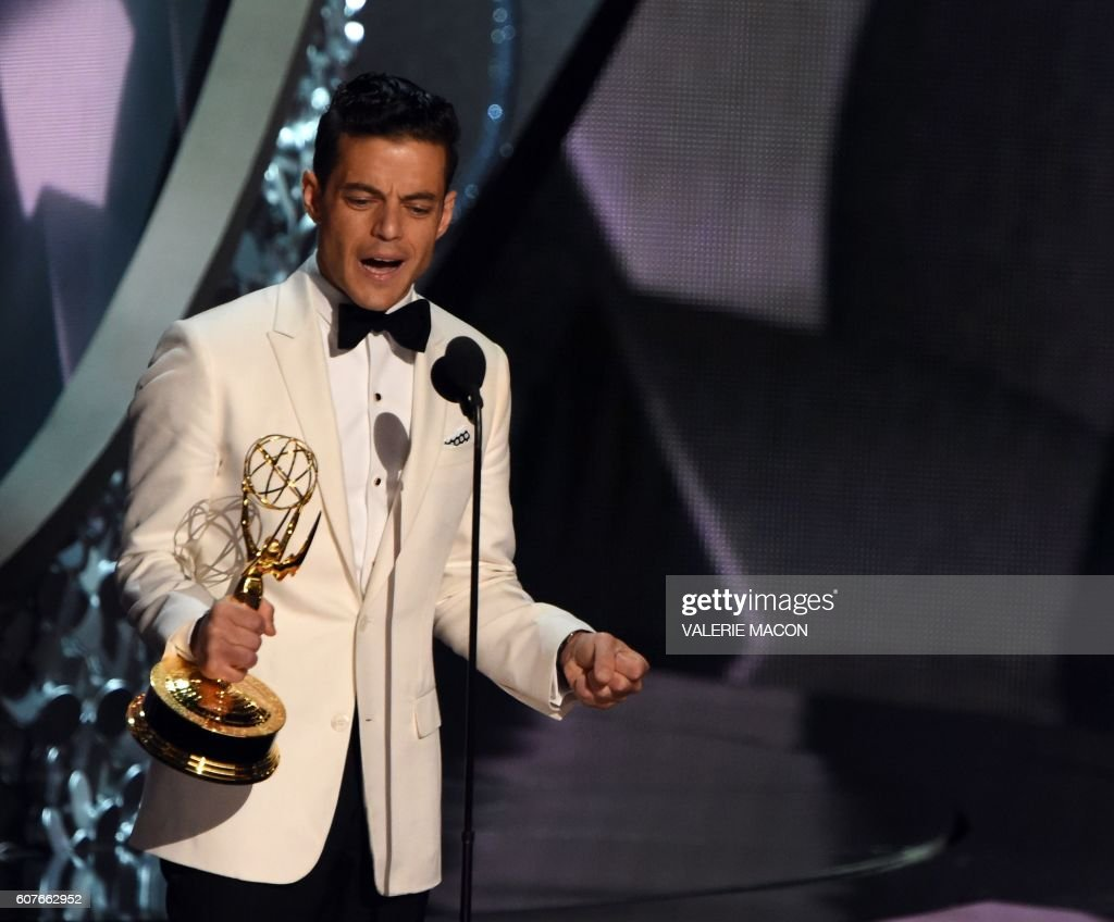 TOPSHOT - Actor Rami Malek accepts the Emmy for Outstanding Lead Actor in a Drama Series during the 68th Emmy Awards show on September 18, 2016 at the Microsoft Theatre in Los Angeles. / AFP PHOTO / Valerie MACON